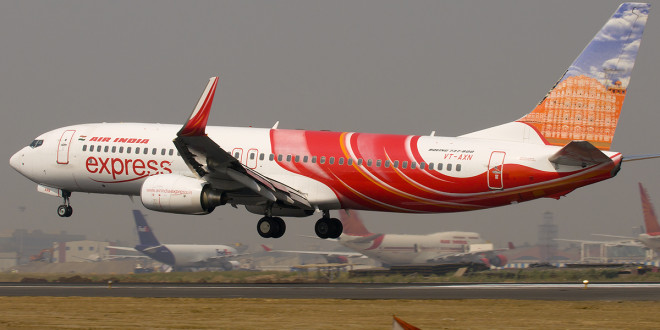 Air India Express Boeing 737-800 VT-AXN lands at Mumbai CSI airport.
