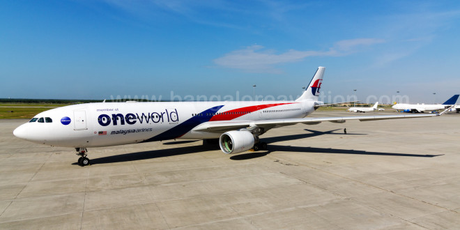 Malaysia Airlines Airbus A330-300 9M-MTE in special oneworld livery. See another photo here. This aircraft performed the first flight of the airline as a member of oneworld in the early hours of Feb 1 from Kuala Lumpur to Melbourne.