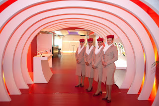 Emirates cabin crew at the Madrid VIP lounge. Airline photo.