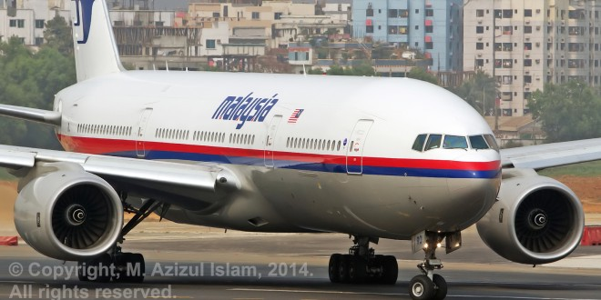 Malaysia Airlines Boeing 777-200ER registration 9M-MRO taken at Dhaka, Bangladesh on 11-Feb-2014. This aircraft went missing while performing flight MH370 from Kuala Lumpur to Beijing with 239 persons on board. Photo copyright M. Azizul Islam