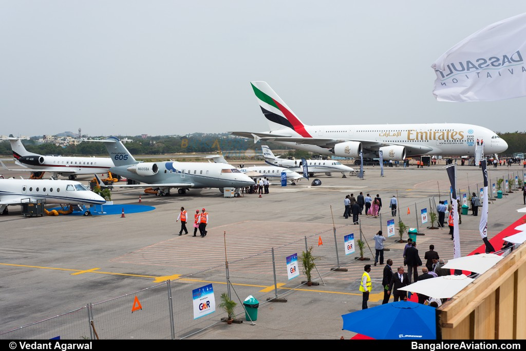 The ramp at India Aviation 2014, the small jets are flanked on one side my the massive Airbus A380 and on the other by the sleek Boeing 787-8.
