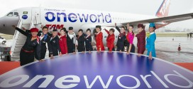 Representative cabin crew of the oneworld member airlines pose in front of TAM airlines A320