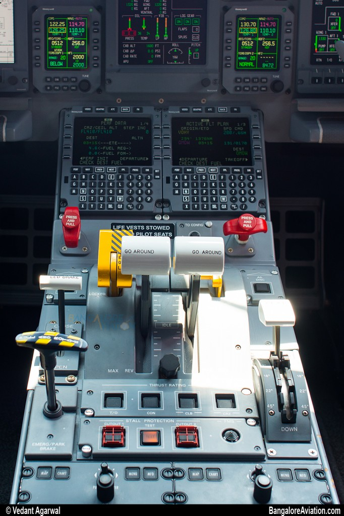 Close up of the thrust, flap and speed brake controls.