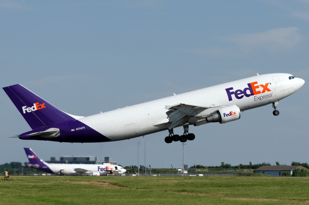 FedEx-Express Airbus A300B4-622R(F) N724FD departs from London Stansted airport. Its sister N727FD in the background.