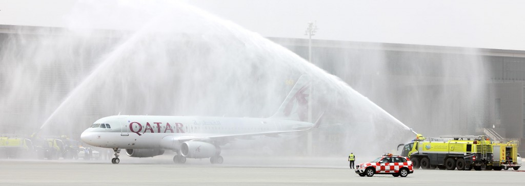 Qatar Airways A320 Sharklet A7-AHX First Flight to arrive at Hamad Intl Airport gets traditional water cannon salute from the HIA ARFF team.