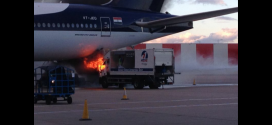 A cleaning truck on fire just below Jet Airways Boeing 777-300ER VT-JEQ at London Heathrow airport