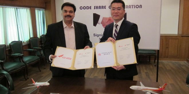 Mr Pankaj Srivastava, commercial director of Air India and Mr. Li Dianchun, commercial director of Hong Kong Airlines sign code-share agreement in Delhi. Photo courtesy the airlines.