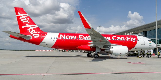First flight of AirAsia India. Plane at the gate.