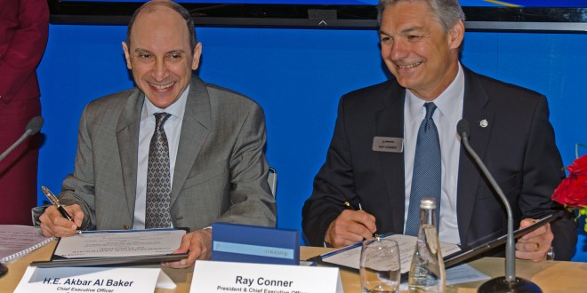 An unusually cheerful Akbar Al Baker, CEO, Qatar Airways with Ray Connor, President, Boeing Commercial Aircraft at 100 777-9X order signing. Farnborough air show 2014.