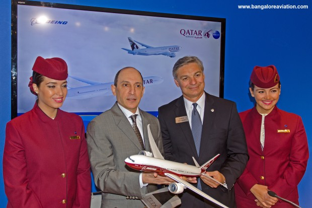 Akbar Al Baker, CEO, Qatar Airways poses with Ray Connor, President, Boeing Commercial Aircraft and Qatar air hostesses cabin crew after the 100 777-9X order signing ceremony at the Farnborough air show 2014.