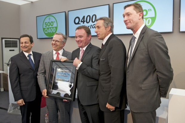 Senior Bombardier executives accept a plaque from Pratt & Whitney celebrating the 500th Q400 order.