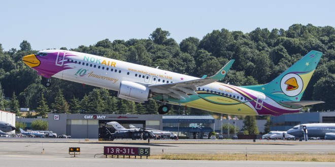 10th anniversary livery Nok Air 737-800 registration HS-DBO takes off from Seattle. Boeing image.