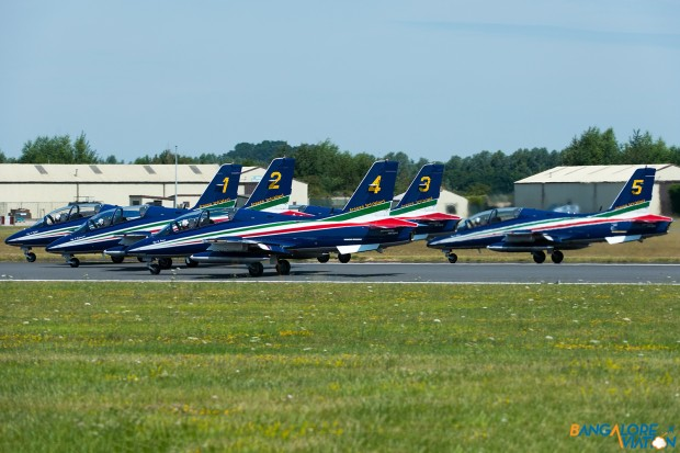 The first five aircraft of the Frecce Tricolori take off for their display.