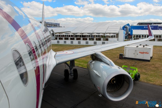The fuselage of the super shiny A320 from the boarding ladder.