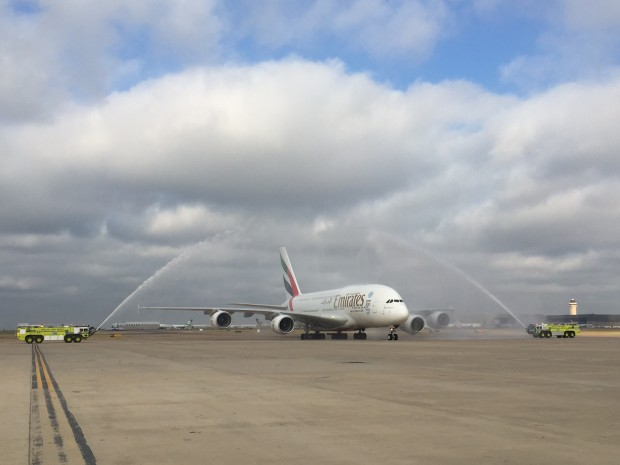 Emirates A380, A6-EET is given a water cannon salute on its first flight to Dallas-Fort Worth airport.