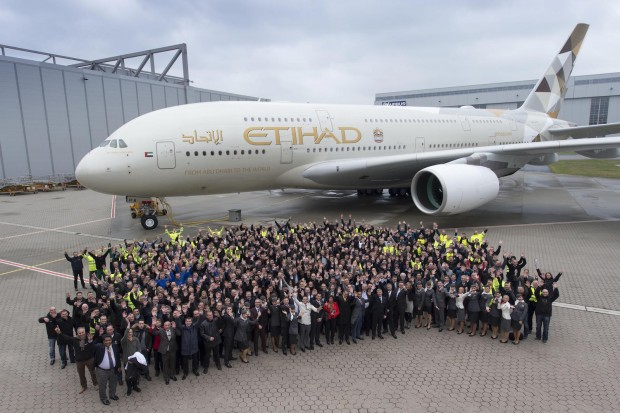 Airbus employees celebrate in Hamburg the handover of the first A380 to Abu Dhabi-based Etihad Airways. Airbus Image.