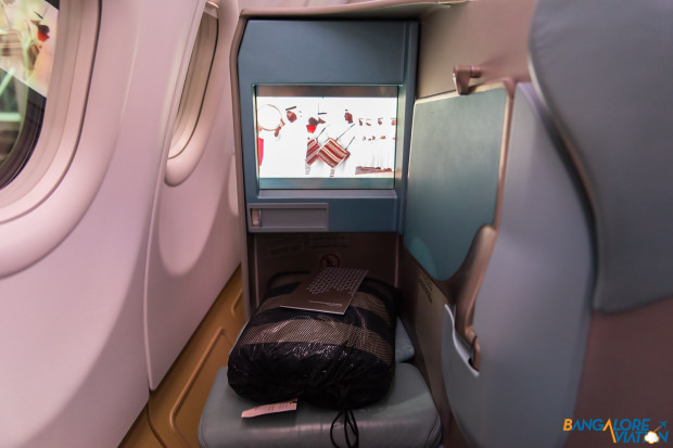 The legroom and screen in Etihad Business class.