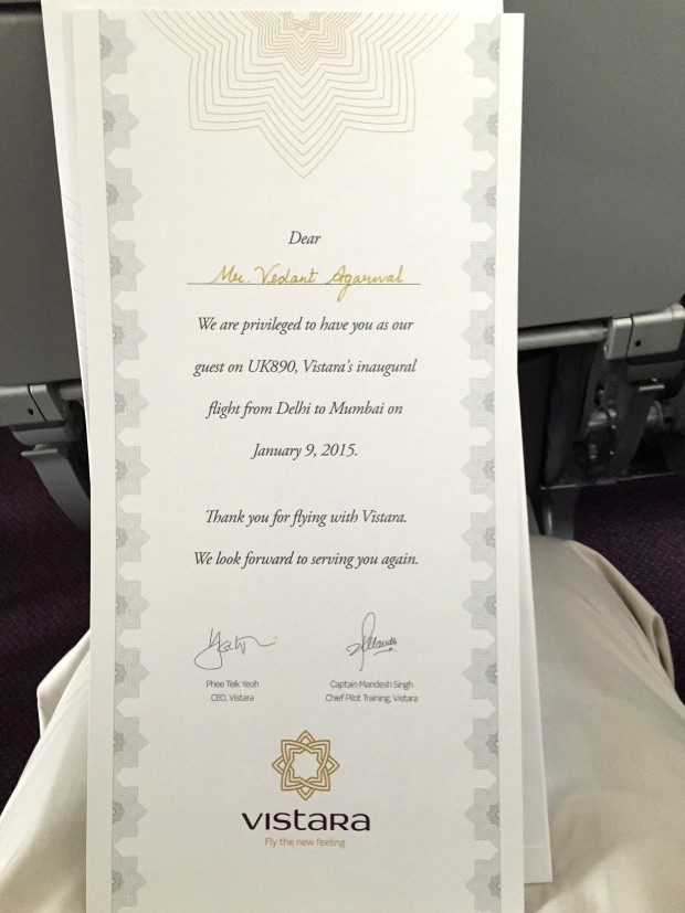 A certificate was given to all passengers who flew on the inaugural flight of Vistara Tata-SIA airline. Also observe the additional three inches of leg-space (33 inch seat pitch) provided in premium economy class.