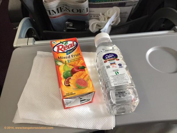 Vistara premium economy class lunch. Fruit juice and water.
