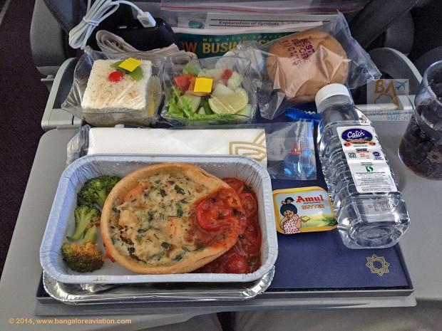 Vistara premium economy class lunch. Leek and prawn quiche with a sandwich and salad.