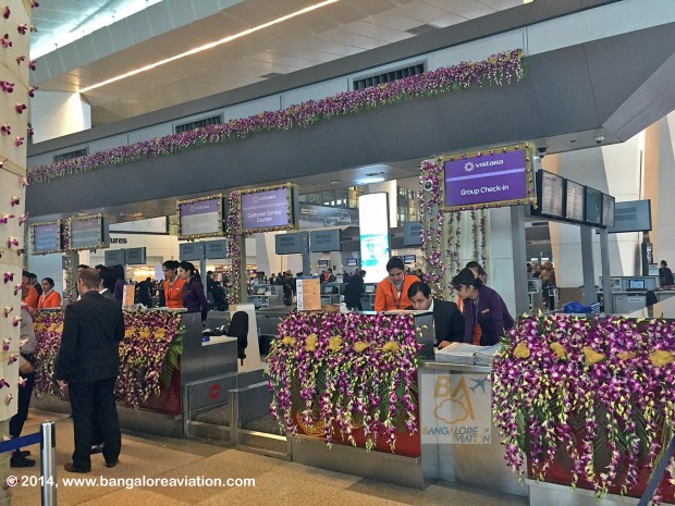 Vistara (Tata-SIA airline) inaugural flight UK890 New Delhi to Mumbai. Check-in counters, decorated with orchids in the corporate purple colour. Image copyright Bangalore Aviation.