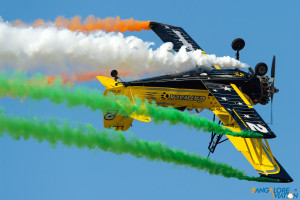 The Ag-Cat trailing the Tricolour behind it in brilliant display.