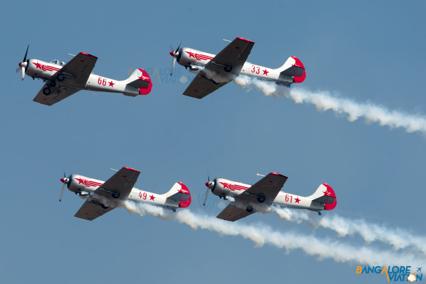 The Yakolevs performing their display. They fly three Yak-50 aircraft and one Yak-52.