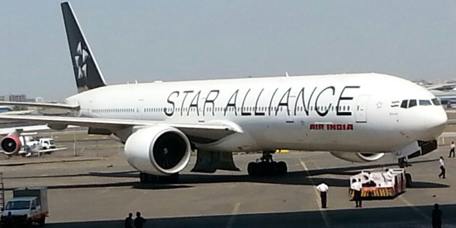 Air India Boeing 777-300ER VT-ALJ Bihar in special Star Alliance livery being wheeled out of the hangar.