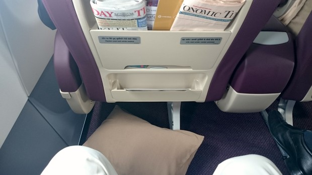 Vistara A320 business class seat. Leg room and news papers.