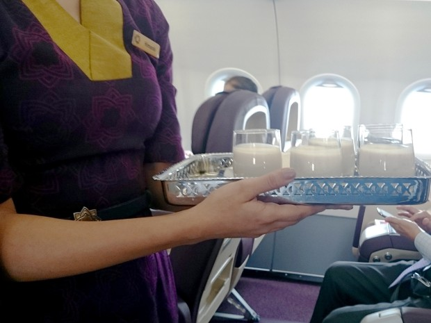 Vistara cabin crew uniform; carrying signature mocktail.
