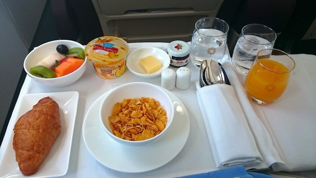 Vistara business class breakfast. Cereal and fruit.