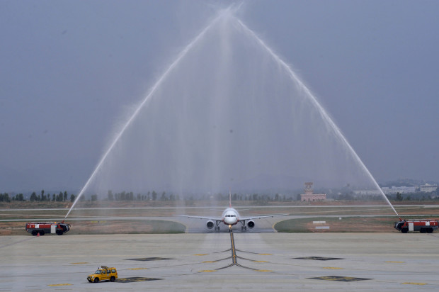 AirAsia India Airbus A320 VT-JRT, crossing the water cannon salute. AirAsia Image.