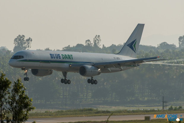 BlueDart Boeing 757-200 VT-BDQ. Observe the vortices coming of the edge of the flaps as the plane approaches the threshold of Runway 27 at Bangalore.