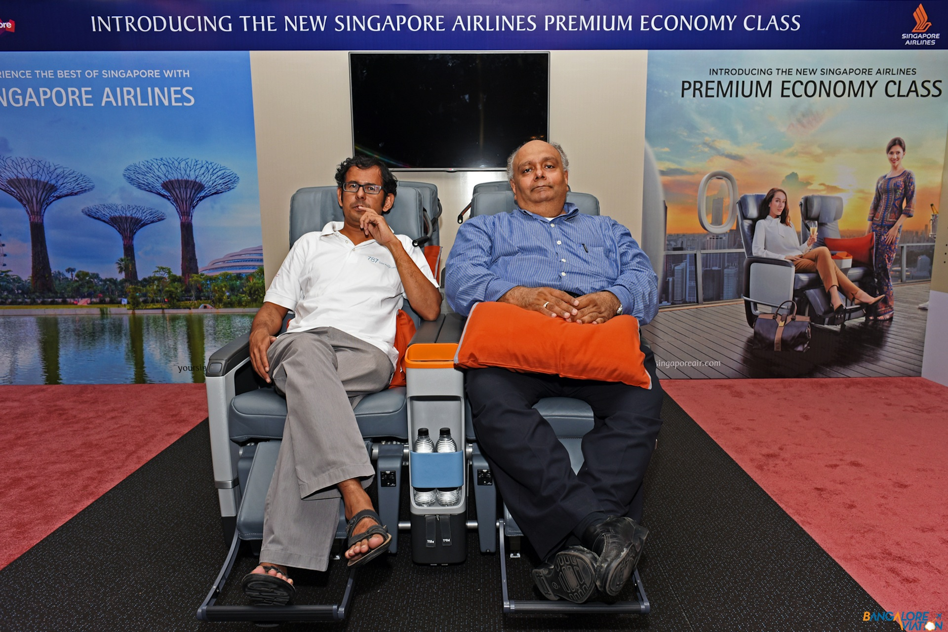 Devesh Agarwal along with another reporter in the Singapore Airlines premium economy class seat