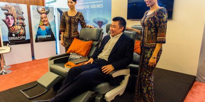 Singapore Airline's India country head David Lau demonstrates the new premium economy seat