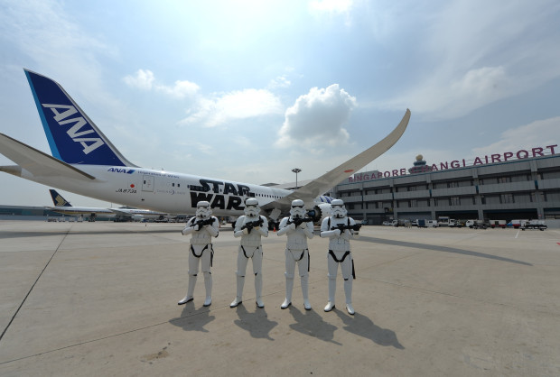 Imperial Stormtroopers with R2-D2 All Nippon Airlines Jet. Photo courtesy Changi Airport