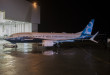 The new 737 MAX 8 rolls out of the paint hangar in Renton.