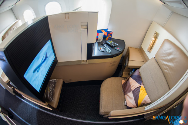 Business class cabin on Etihad's Boeing 787-9. Privacy screen raised