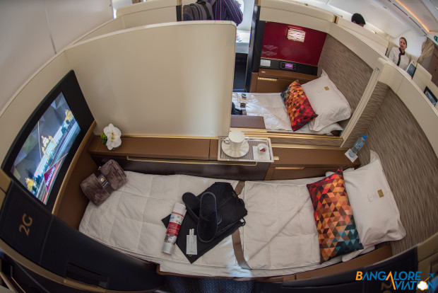 Suite 2D and 2G showing the lie flat bed after being turned down. Etihad First Class Boeing 787-9.