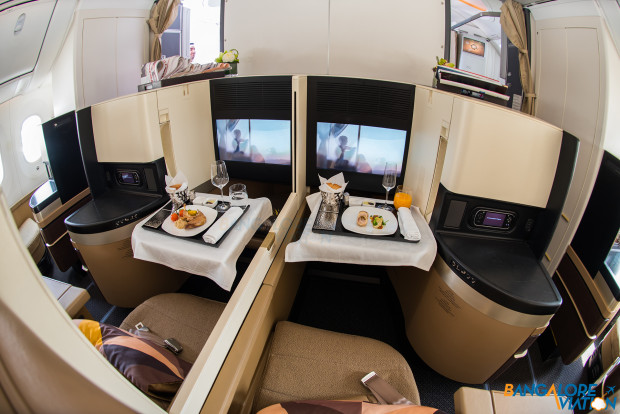 A close up of a pair forward center seats. Business class cabin on Etihad's Boeing 787-9.