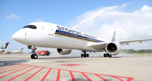 First A350 XWB of Singapore Airlines receives the traditional water cannon salute at Singapore Changi airport.