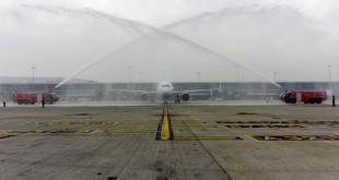 IndiGo first A320neo VT-ITC receives the traditional water cannon welcome from the IGI airport ARFF team