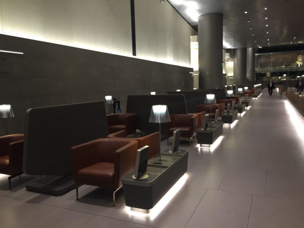 Seating at the Al Mourjan lounge. Observe the partitions between seats that provide privacy to each passenger.
