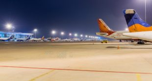 View of part of the ramp at Bangalore Airport at night.