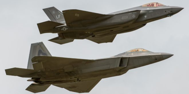 The US Air Force F-22A Raptor and F-35A Lightning II fly in formation.