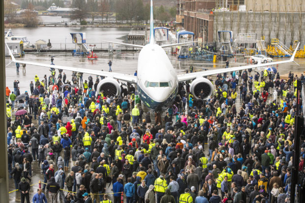 The 737 MAX 9 along with plant employees. Boeing Image.