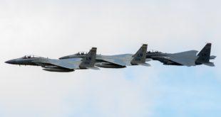 Two McDonnell Douglas F-15C Eagles with a McDonnell Douglas F-15E Strike Eagle.