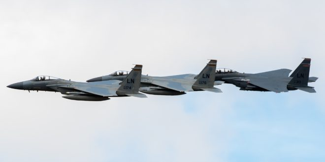Two McDonnell Douglas F-15C Eagles with a McDonnell Douglas F-15E Strike Eagle.