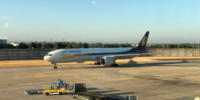 A Jet Airways Boeing 777-300ER pulling into it's gate at London Heathrow.