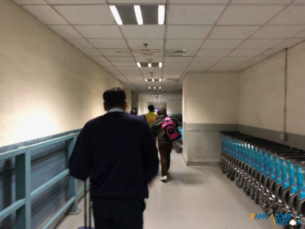 The staff tunnel running from security straight to the lounge.